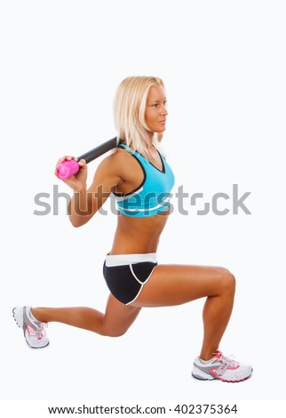 Blond female doing legs workouts. Isolated on a white background.