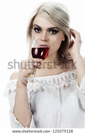 blond female fashion model holding glass  of rose wine - stock photo