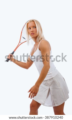 Blond female in a white dress holds tennis racket. - stock photo