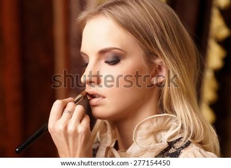 Blond female in hair salon - stock photo