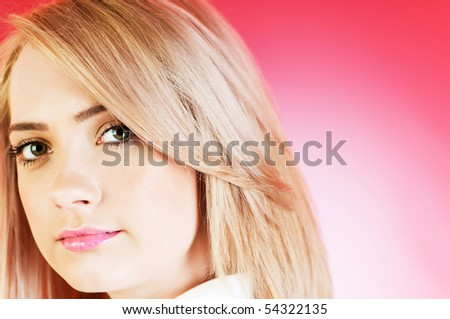 Blond girl against colourful background