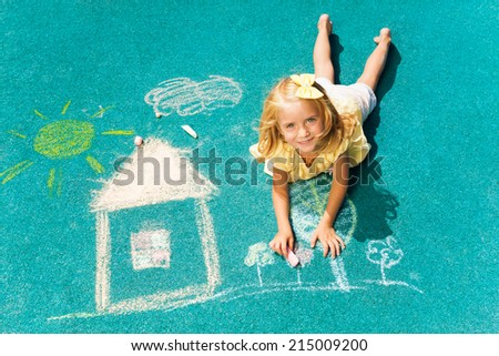 Blond girl and chalked drawing