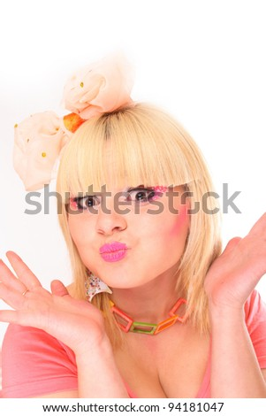 Blond girl care her face by cosmetic brush