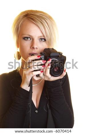 Blond girl holding a camera - stock photo