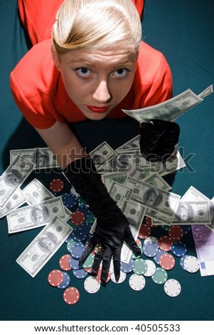 Blond girl holding a large sum of dollar cash - stock photo