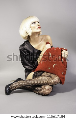 Blond girl holding a pillow - stock photo
