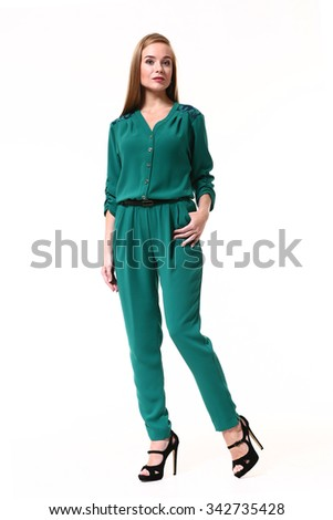 blond girl in emerald overall and hugh heel black sandals isolated on white full length portrait - stock photo