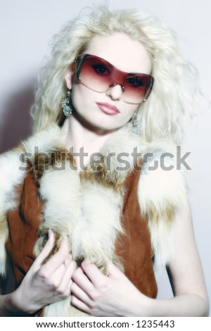 Blond girl in glasses, a close up
