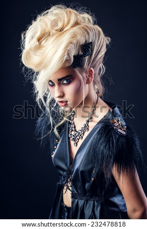 blond girl in rock style clothing - stock photo