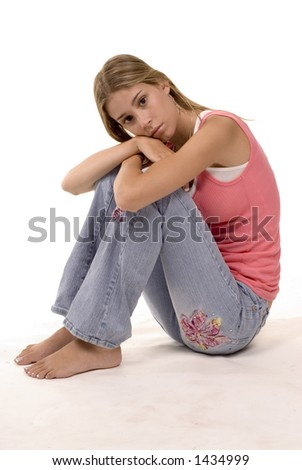 blond girl in thought - sitting in casual jeans