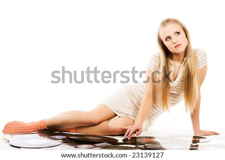 blond girl laying on white with vinyl records