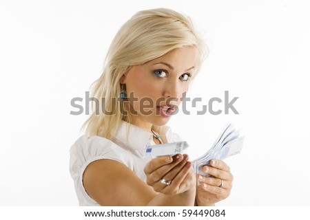 blond girl looking in camera with some money in hand in act to give an euro bill - stock photo