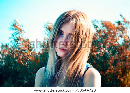 blond girl on a background of yellow flowers