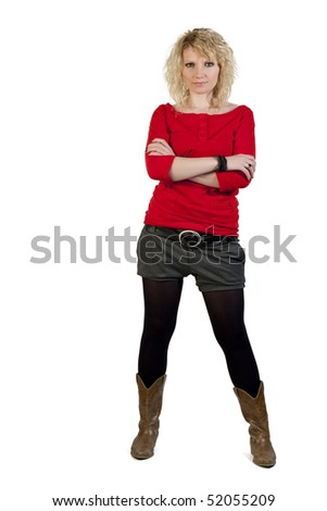 Blond girl standing on a white background