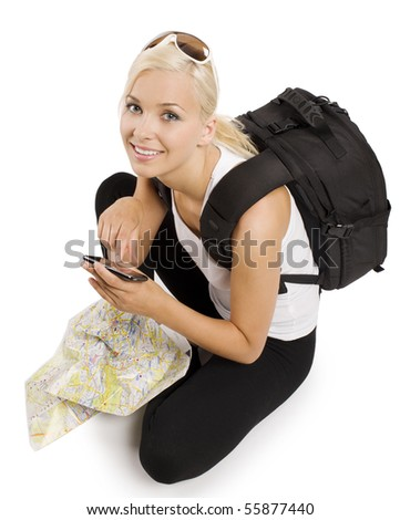 blond girl tourist with map sitting down and using a gps to find the right way - stock photo