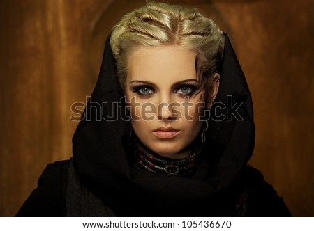 Blond girl with a ethnic necklace portrait - stock photo