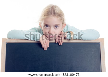 blond girl with blackboard in front of white background