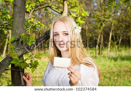 Blond girl with business card - stock photo
