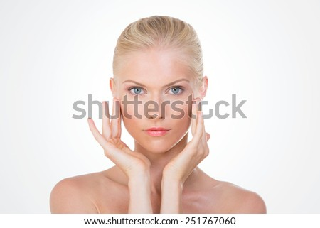 blond girl with hands on her face - stock photo