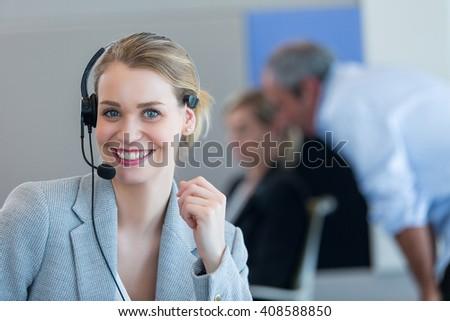 blond girl with headphones - stock photo