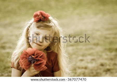 blond girl with long hair and red flowers sepia toned
