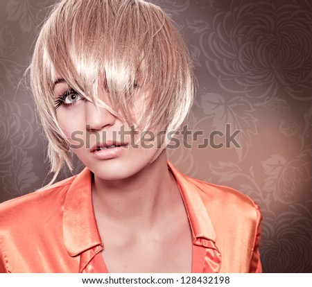 blond girl with wild pageboy cut - stock photo