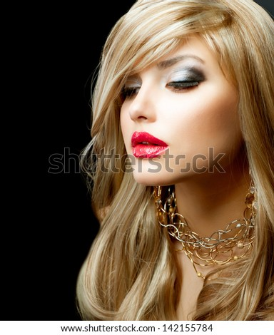 Blond Hair. Beautiful Blond Woman with Holiday Makeup over Black Background. Red Lipstick - stock photo