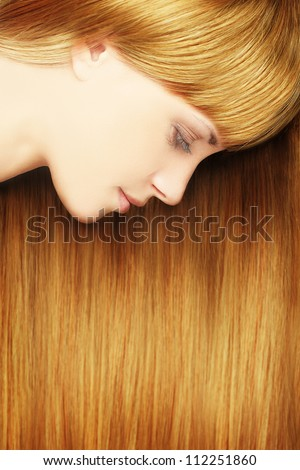 Blond hair - beautiful woman with healthy long hair - stock photo