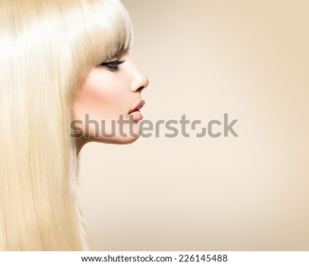 Blond Hair. Blonde Beauty girl with long smooth shiny hair. Fringe Haircut. Beautiful Girl with Healthy Long Hair. Hairstyle  - stock photo