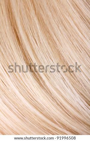 Blond hair extension, macro - stock photo