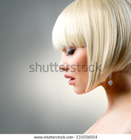 Blond Hair. Haircut. Beautiful Girl with Healthy Short Hair. Hairstyle. Bob. Fringe. Profile Portrait of Fashion Beauty Woman - stock photo