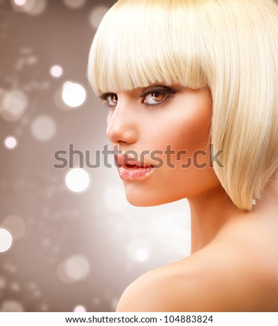 Blond Hair. Haircut. Hairstyle. Beautiful Model over Blinking Holiday Background - stock photo