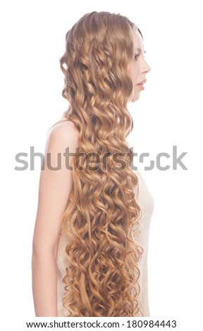 Blond Hair. Young Beautiful Caucasian Woman with Curly Long Hair. Isolated on white background
