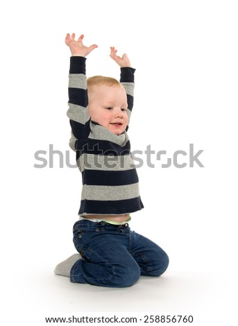Blond headed 2-year-old boy with striped shirt on white background - stock photo