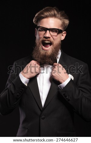 Blond hipster business man screaming while fixing his bow tie.