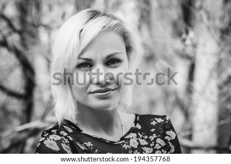 blond in the forest black and white