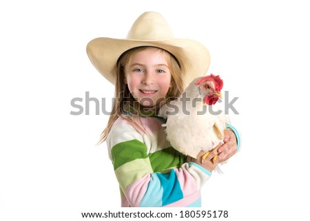 Blond kid girl farmer holding white hen on arms with cowboy hat - stock photo