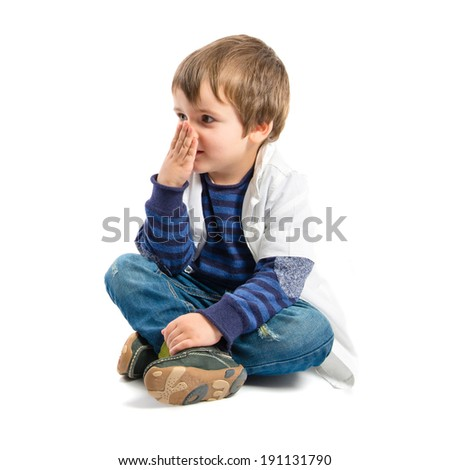 Blond kid sit on the floor over white background