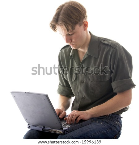 blond man in khaki shirt with laptop on white