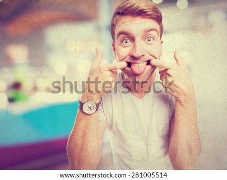 blond man joking - stock photo