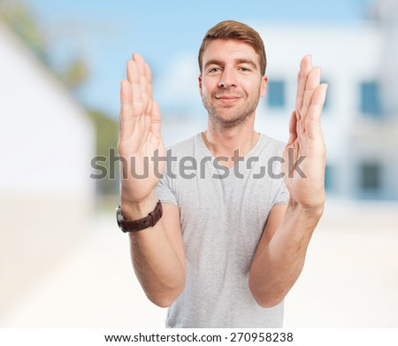 blond man show sign - stock photo