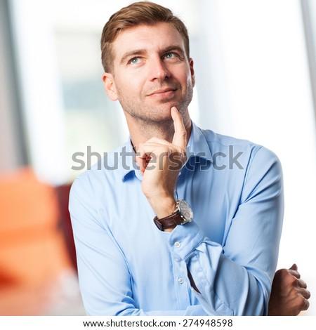 blond man thinking - stock photo
