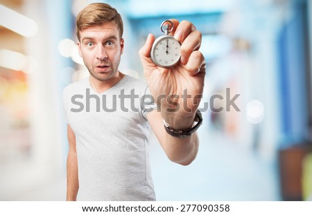 blond man with a stopwatch - stock photo