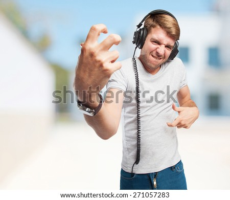 blond man with headphones
