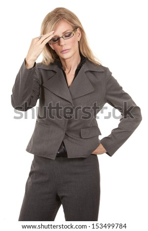 blond mature woman having a headache on white background - stock photo