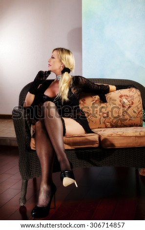 Blond Middle Aged Woman Sitting In Stockings Dress