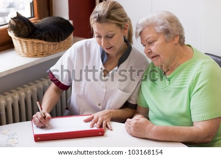 blond nurse visiting a senior patient at home