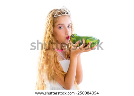 blond princess girl kissing a frog green toad like a story tale on white - stock photo