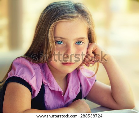 Blond relaxed sad kid girl expression blue eyes portrait - stock photo