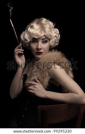Blond retro-styled woman with cigarette over black